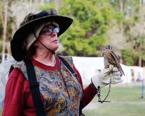 Woman with Tiny Bird of Prey