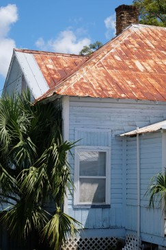 Rusted Roof Blue House